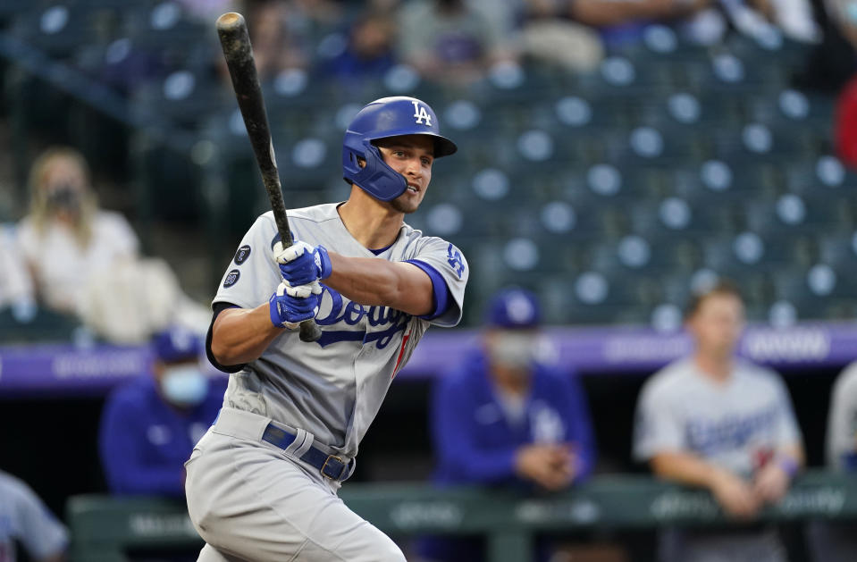 Los Angeles Dodgers' Corey Seager follows the flight of his RBI-double off Colorado Rockies starting pitcher Antonio Senzatela in the second inning of a baseball game Friday, April 2, 2021, in Denver. (AP Photo/David Zalubowski)