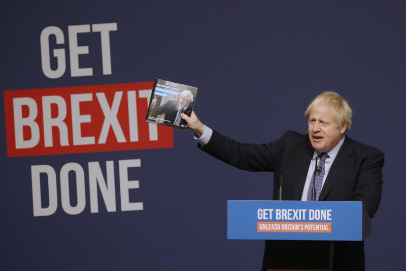 Britain's Prime Minister Boris Johnson presents the Conservative Party's Manifesto for the General Election campaign, in Telford, England, Sunday, Nov. 24, 2019. Britain goes to the polls on Dec. 12. (AP Photo/Frank Augstein)