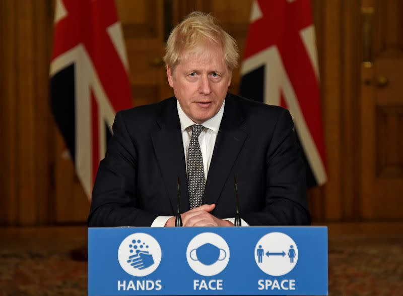 FILE PHOTO: Britain's Prime Minister Boris Johnson speaks during a press conference at 10 Downing Street in London