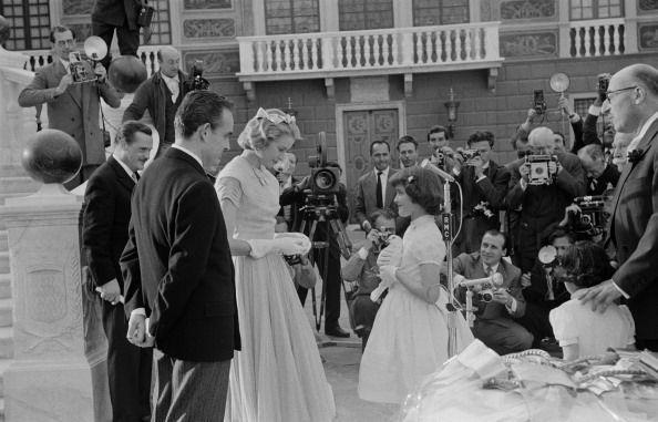<p>The day before the wedding, Kelly and Prince Rainier had a ceremony for receiving wedding gifts. Here, the couple is given a white dove by a young girl. </p>