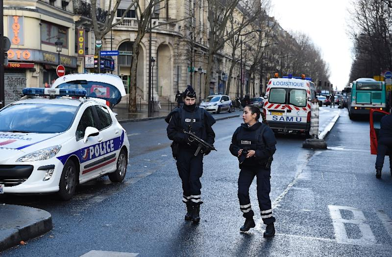 Six prestigious schools in central Paris are evacuated after anonymous calls claim that bombs had been hidden in the buildings (AFP Photo/Lionel Bonaventure)