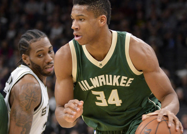 All-Stars Giannis Antetokounmpo and Kawhi Leonard will both miss Monday's marquee meeting between their two teams. (AP)