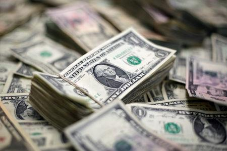Dollar slips as U.S. jobs report tempers rate hike bets