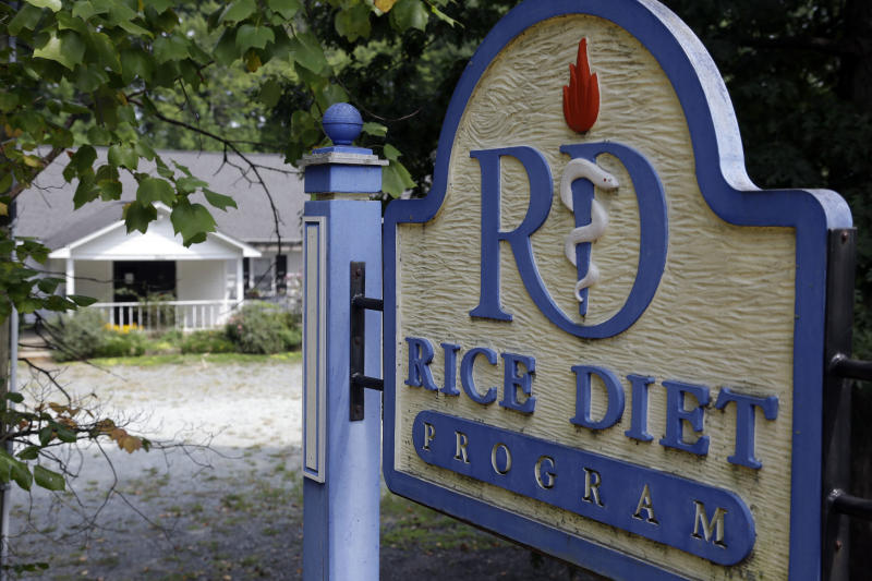 This Tuesday, Aug. 27, 2013 photo shows a sign in front of the now-closed Rice Diet facility in Durham, N.C. The company that took the Rice Diet banner after Duke University's hospital spun it off a decade ago has closed after more than 70 years of attracting celebrities and others suffering chronic illness and obesity to Durham. (AP Photo/Gerry Broome)
