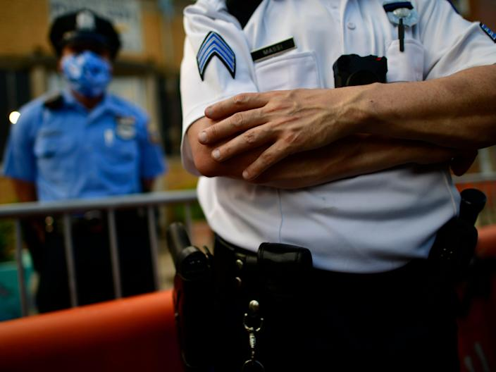 A police officer crosses his arms while observing protesters outside the 26th Precinct on June 3, 2020, in Philadelphia, Pennsylvania.