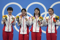 China's women's 4x200-meter freestyle relay team, from left, Yang Junxuan, Tang Muhan, Zhang Yifan and Li Bingjie pose with their gold medals at the 2020 Summer Olympics, Thursday, July 29, 2021, in Tokyo, Japan. (AP Photo/Matthias Schrader)