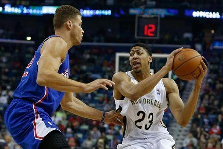 New Orleans Pelicans forward Anthony Davis (23) is guarded by Los Angeles Clippers forward Blake Griffin (32) during the first quarter of a game at the Smoothie King Center. Derick E. Hingle-USA TODAY Sports - RTR3IQZY