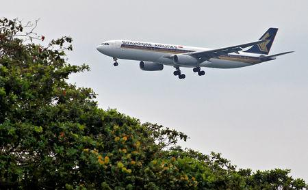 A Singapore Airlines Airbus A330 airplane approaches to land at Changi International Airport in Singapore