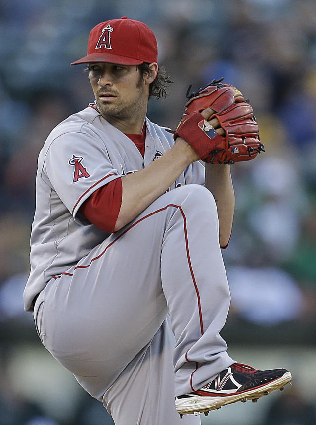 Los Angeles Angels' C.J. Wilson works against the Oakland Athletics in the first inning of a baseball game on Thursday, July 25, 2013, in Oakland, Calif. (AP Photo/Ben Margot)