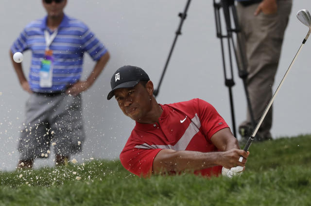 Tiger Woods hits from a bunker on the 13th hole during the final round of the BMW Championship golf tournament at Medinah Country Club, Sunday, Aug. 18, 2019, in Medinah, Ill. (AP Photo/Nam Y. Huh)