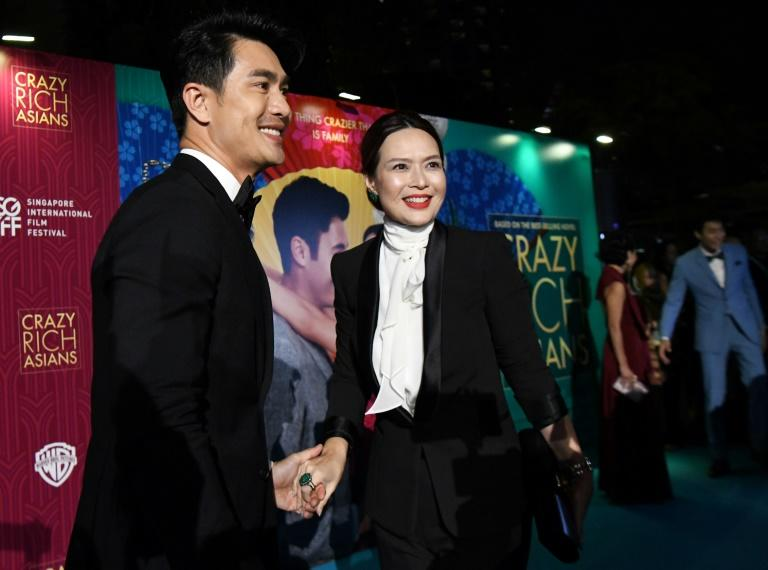 "Actor Pierre Png and wife Andrea De Cruz arrive at the Singapore premiere of ""Crazy Rich Asians"". The rom-com, which tells the story of an ordinary Asian-American woman and her super-rich boyfriend, will likely do well in parts of Asia"
