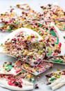 """<p>This beautiful bark is made with white chocolate, dried cranberries, and chopped pistachios.</p><p><strong>Get the recipe at <a href=""""https://www.jocooks.com/recipes/christmas-candy-cane-bark/"""" rel=""""nofollow noopener"""" target=""""_blank"""" data-ylk=""""slk:Jo Cooks"""" class=""""link rapid-noclick-resp"""">Jo Cooks</a>.</strong><br></p>"""