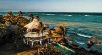 """<p>Far less trafficked than the neighboring Seychelles, one of the most awe-inspiring settings in the world is the inimitable and utterly fabulous <a rel=""""nofollow noopener"""" href=""""http://www.alfajirivillas.com/"""" target=""""_blank"""" data-ylk=""""slk:Alfajiri Villas"""" class=""""link rapid-noclick-resp"""">Alfajiri Villas</a> on Diani Beach in the Kenyan Coast. Just a short flight from Nairobi lay 3 of the most luxurious and well-appointed villas the world over, each with their own charm. Privacy isn't a privilege but assumed here, as the properties can be separated or booked together, but no matter how large your tour group, you're in for one of the best views in the world. </p><p>The Cliff Villa's master bedroom has, arguably, the best view on the property of the vast ocean expanse, but all properties are perched in a setting that will inspire. Everything at Alfajiri is built to put you at ease, including a daily massage in dedicated areas where you can feel the sea breeze come through as your troubles melt away. The food here is out of this world and includes fresh lobster, lumps of white crab meat salad and delicious, perfectly cooked Arrabiata pasta (owner Marika and her husband Fabrizio have expertly trained local chefs to prepare it perfectly). </p><p>Genteel, barefoot luxury reigns supreme here, where charming white coated butlers are on hand at all times to make your stay special. The perfect place for a honeymoon, family gathering or even group of friends, Alfajiri Villas' position overlooking the Indian Ocean is as dramatic as it is an unconventional choice; this 'in the know' element is part of its breezy charm–it seems Brad and Angelina had the right idea when they chose this as their honeymoon destination.</p>"""