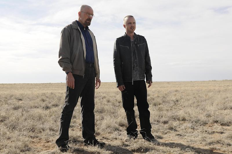"""This image released by AMC shows Bryan Cranston as Walter White, left, and Aaron Paul as Jesse Pinkman in a scene from the season 5 premiere of """"Breaking Bad.""""  The program was nominated for an Emmy award for outstanding drama series on Thursday, July 19, 2012. The 64th annual Primetime Emmy Awards will be presented Sept. 23 at the Nokia Theatre in Los Angeles, hosted by Jimmy Kimmel and airing live on ABC. (AP Photo/AMC, Ursula Coyote)"""