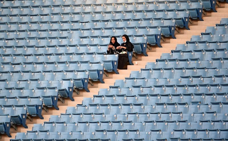 Saudi women sit in a Riyadh stadium for the first time to attend Saudi national day on September 23, 2017