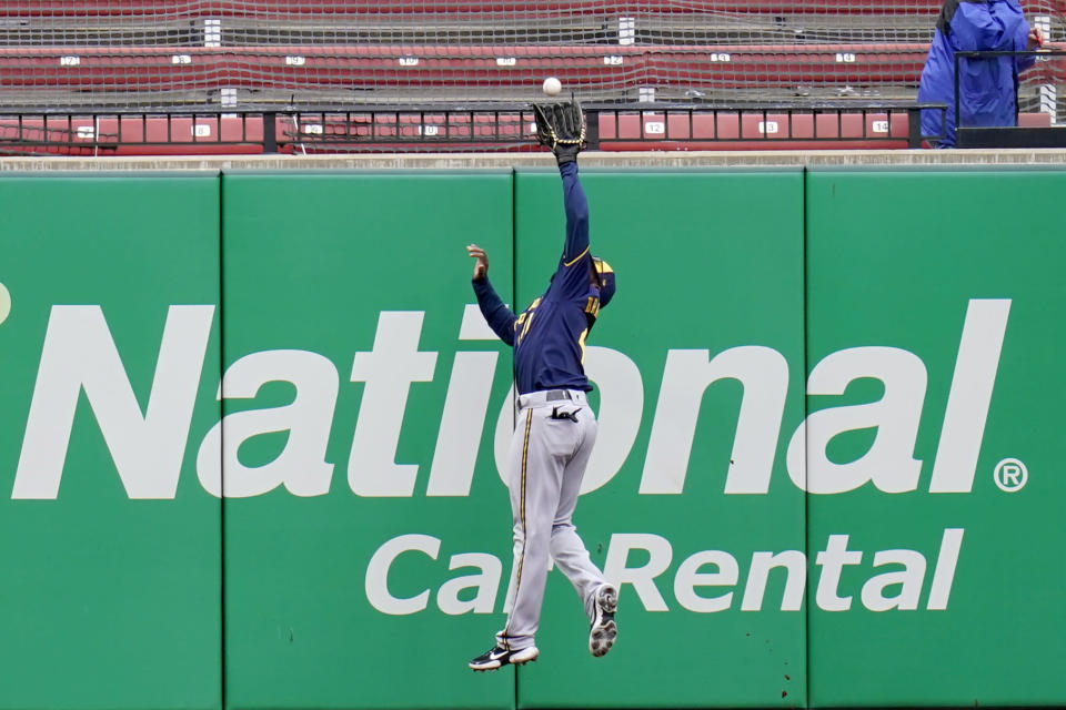 Milwaukee Brewers center fielder Jackie Bradley Jr. leaps to catch a fly ball by St. Louis Cardinals' Justin Williams for an out during the eighth inning of a baseball game Saturday, April 10, 2021, in St. Louis. (AP Photo/Jeff Roberson)