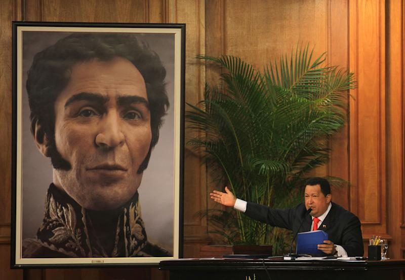 Venezuela's President Hugo Chavez unveils a photograph-like portrait of Venezuela's independence hero Simon Bolivar on the 229th anniversary of Bolivar's birth at Miraflores presidential palace in Caracas, Venezuela, Tuesday, July 24, 2012.  A team of researchers produced the image based on studies of Bolivar's remains.  (AP Photo/Fernando Llano)