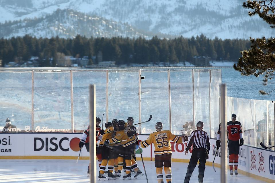 <p>David Pastrnak #88 of the Boston Bruins is congratulated by his teammates after scoring a goal against the Philadelphia Flyers in the first period during the 'NHL Outdoors At Lake Tahoe' at the Edgewood Tahoe Resort on February 21, 2021 in Stateline, Nevada. (Photo by Ezra Shaw/Getty Images)</p>