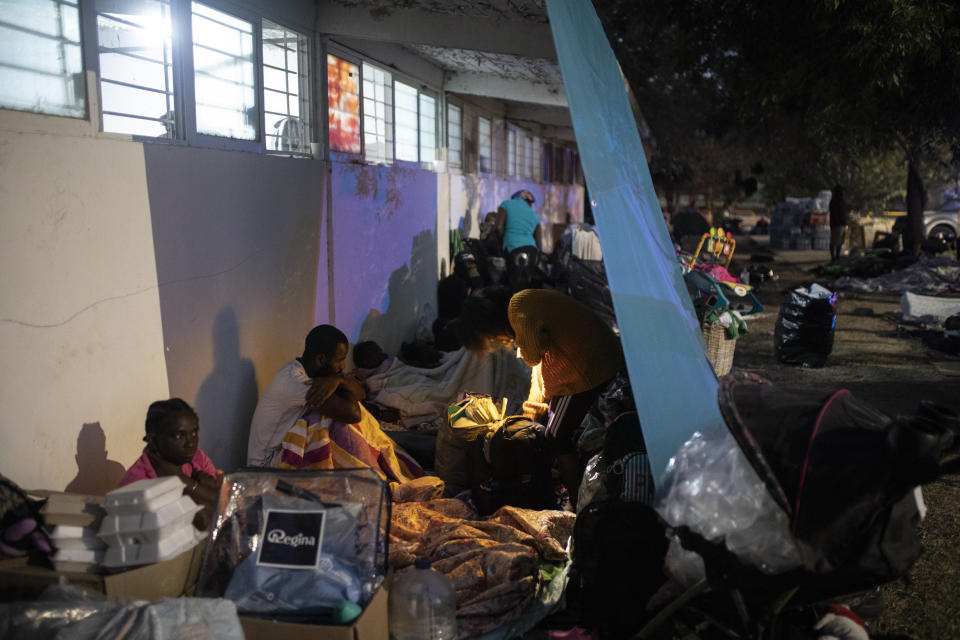 Migrants trying to reach the U.S., many from Haiti, camp out in Ciudad Acuna, Mexico, at dawn Thursday, Sept. 23, 2021, across the Rio Grande river, the natural border with Del Rio, Texas. (AP Photo/Felix Marquez)