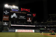 The scoreboard shows an image of the George Floyd after a baseball game between the Washington Nationals and the St. Louis Cardinals, Tuesday, April 20, 2021, in Washington. The Nationals won 3-2. (AP Photo/Nick Wass)