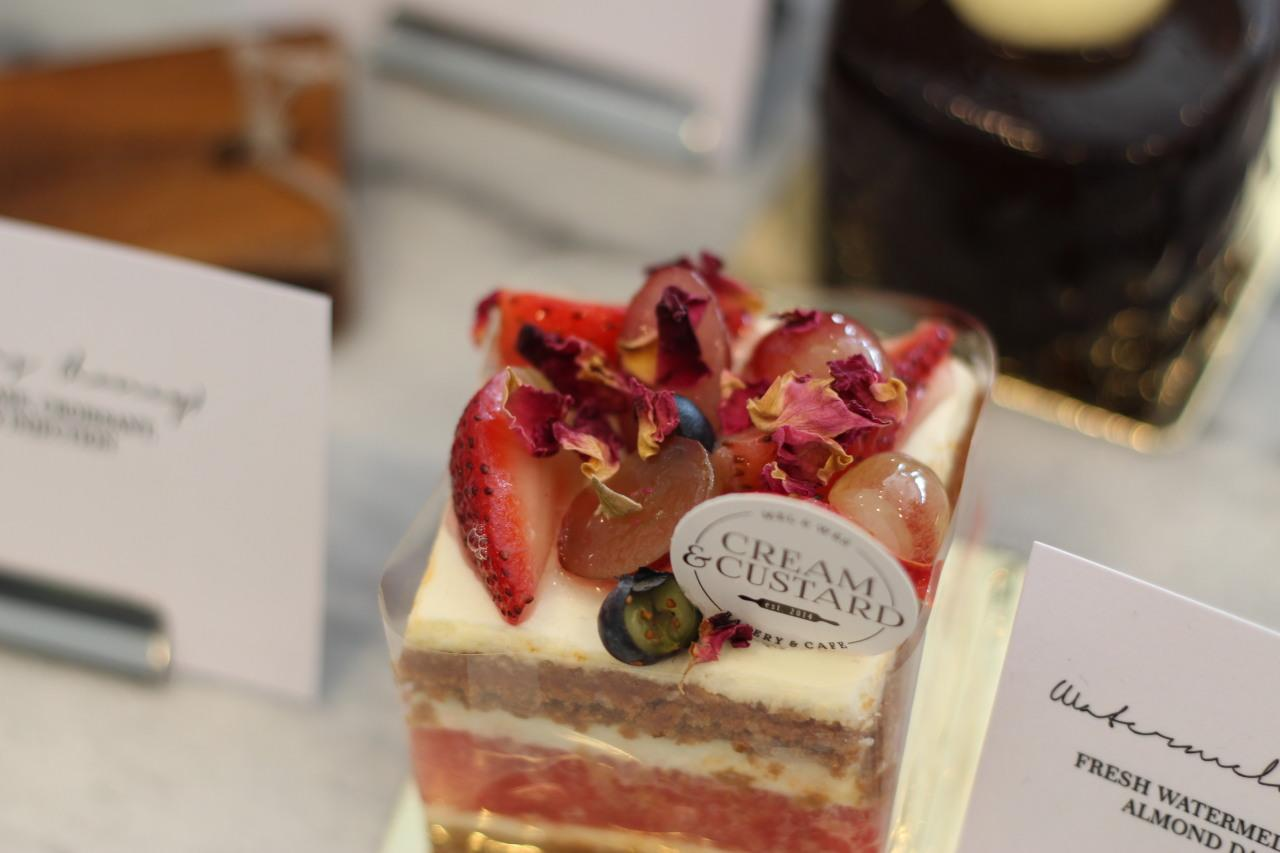 <p>Cream & Custard cafe really knows how to dress up their cakes — especially this beautiful edible artwork called Watermelon Strawberry, which is made of fresh watermelon, strawberry, grapes, almond dacquoise and rose petals.</p>