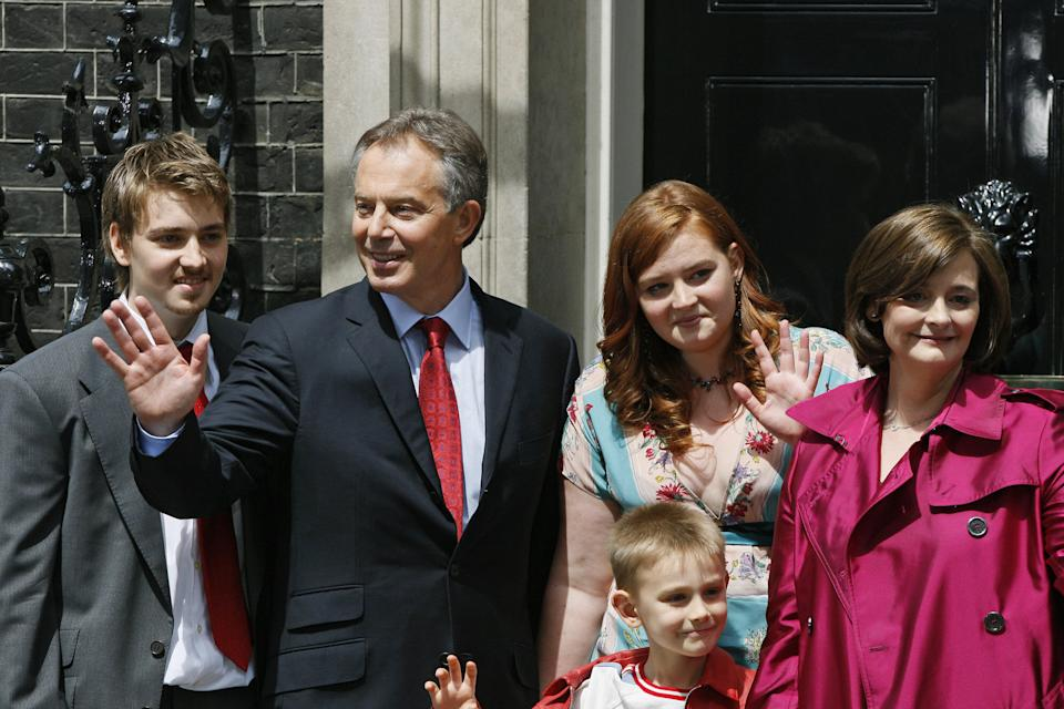 Euan, far left, stood next to father Tony Blair in front of 10 Downing Street as Blair and his family said goodbye to media in central London, on 27 June 2007. Photo: Adrian Dennis/AFP via Getty Images