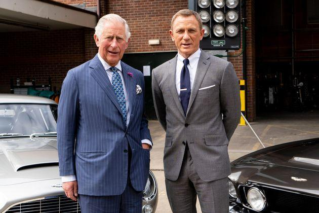 Charles poses with Daniel Craig as he tours the set of the 25th James Bond film at Pinewood Studios on June 20, 2019, in Iver Heath, England. (Photo: WPA Pool via Getty Images)