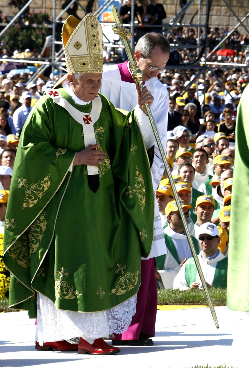 Pope Benedict XVI is helped by Monsignor Guido Marini, Master of Liturgical ceremony prior to celebrate an open-air mass at Palermo, in the island of Sicily, Sunday, Oct. 3, 2010. Pope Benedict XVI paid tribute Sunday to a Palermo priest slain by the Mafia and encouraged Sicilians not to resign themselves to deep-rooted evil on an island where organized crime has held sway for centuries. (AP Photo/Pier Paolo Cito)