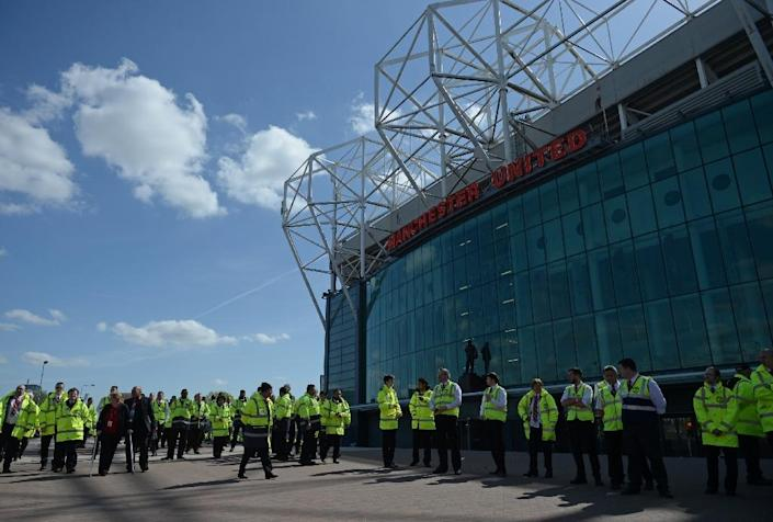 Evacuated stewards wait outside Old Trafford stadium in Manchester, north-west England, on May 15, 2016, after the Premier League match between Manchester United and Bournemouth was abandoned over a suspect package (AFP Photo/Oli Scarff)