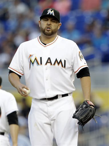Miami Marlins' Ricky Nolasco reacts after giving up a single to Cincinnati Reds' Joey Votto in the first inning of a baseball game in Miami, Tuesday, May 14, 2013. (AP Photo/Lynne Sladky)