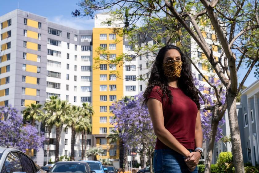 "Sabrina Knight, 26, is worried about the spread of the novel coronavirus within Park La Brea, the largest apartment complex west of the Mississippi River, but she's happy living there. <span class=""copyright"">(Kent Nishimura / Los Angeles Times)</span>"