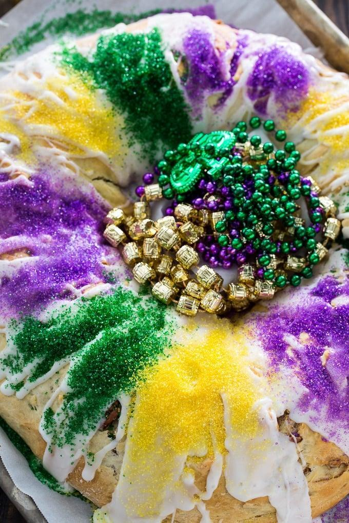 """<p>You can't celebrate Mardi Gras without eating a king cake, right? This cinnamon-pecan recipe is all you need to get the party started. It's easy to make at home, so you can bring the flavors of Louisiana right to your kitchen.</p> <p><strong>Get the recipe</strong>: <a href=""""https://spicysouthernkitchen.com/cinnamon-pecan-king-cake/"""" class=""""link rapid-noclick-resp"""" rel=""""nofollow noopener"""" target=""""_blank"""" data-ylk=""""slk:cinnamon-pecan king cake"""">cinnamon-pecan king cake</a></p>"""