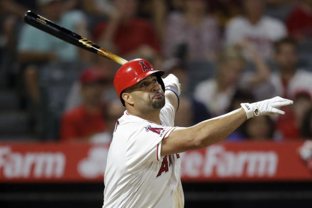 Los Angeles Angels' Albert Pujols watches his three-run home run against the Boston Red Sox during the eighth inning of a baseball game in Anaheim, Calif., Saturday, Aug. 31, 2019. (AP Photo/Chris Carlson)