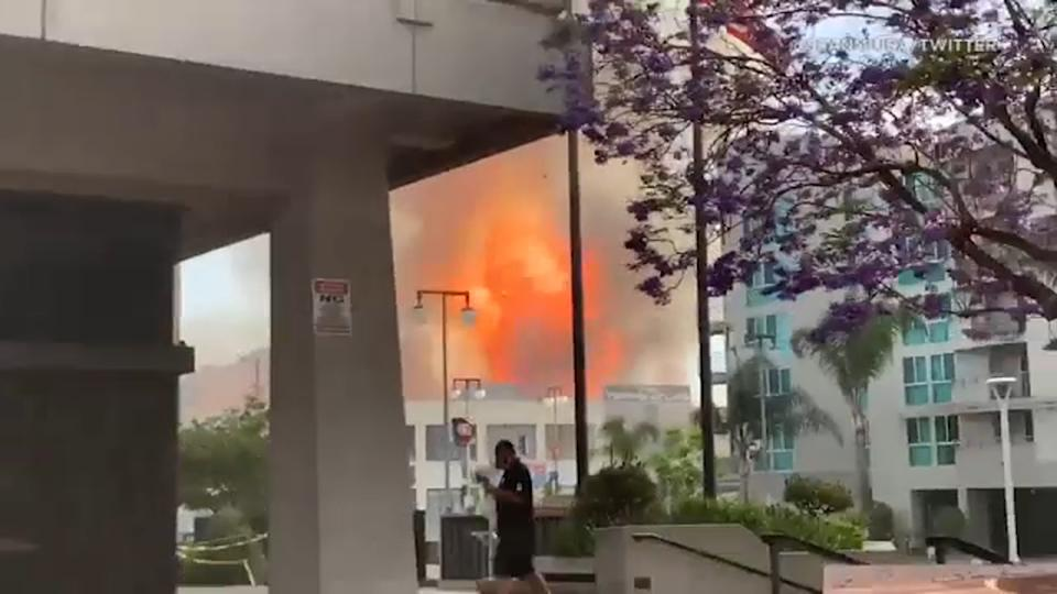 Multiple firefighters were injured after an explosion in downtown Los Angeles Saturday evening, leaving several buildings on fire, officials said.