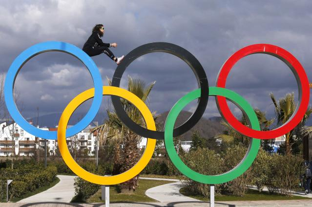 U.S. speed skater Maria Lamb sits inside a set of Olympic rings in the Coastal Athlete's Village, February 4, 2014. Sochi will host the 2014 Winter Olympic Games from February 7 to February 23. REUTERS/Alexander Demianchuk (RUSSIA - Tags: SPORT OLYMPICS)