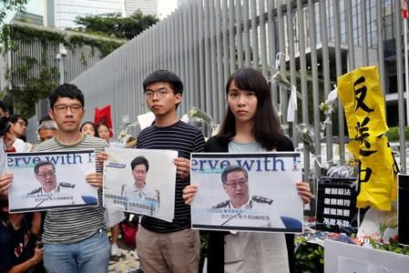 FILE PHOTO: Pro-democracy activists Nathan Law, Joshua Wong and Agnes Chow attend a news conference regarding the proposed extradition bill, outside the Legislative Council building in Hong Kong
