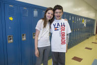 In this Thursday, June 6, 2013 photo, Kristin Merrilees, left, and her twin brother, Henry, one of the twenty-four sets of twins from Highcrest Middle School in Wilmette, Ill. pose for a portrait at the school. The group is attempting to break a Guinness World record for the amount of twins in one grade which is currently 16 sets. (AP Photo/Scott Eisen)