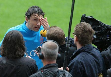 File Photo: Netherlands' player Mark Van Bommel talks with reporters at the end of a training session during the Euro 2012 at Wisla stadium in Krakow June 05, 2012. REUTERS/Tony Gentile