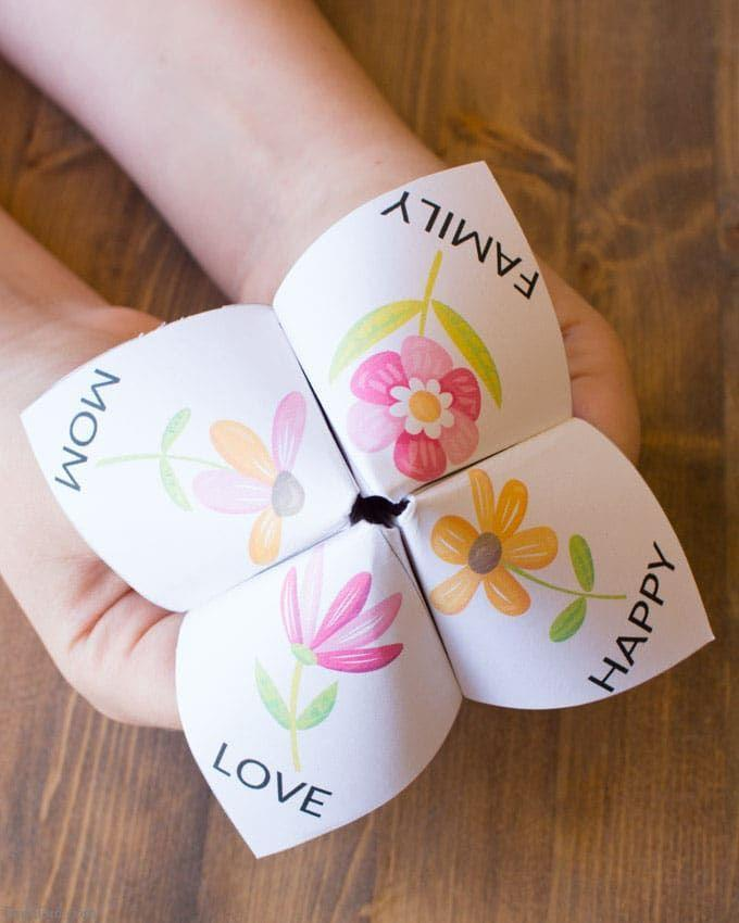 """<p>The little ones can color their own mom-friendly cootie catcher, which features interior prompts like """"give a compliment to your mom"""" or """"give your mom a big hug.""""</p><p><strong>Get the tutorial at <a href=""""https://brendid.com/easy-mothers-day-craft-for-kids-fortune-teller/?utm_medium=social&utm_source=pinterest&utm_campaign=tailwind_smartloop&utm_content=smartloop&utm_term=19056990"""" rel=""""nofollow noopener"""" target=""""_blank"""" data-ylk=""""slk:Bren Did"""" class=""""link rapid-noclick-resp"""">Bren Did</a>. </strong></p><p><strong><a class=""""link rapid-noclick-resp"""" href=""""https://www.amazon.com/Printworks-Inkjet-Printers-Printable-00548/dp/B003FMVCVQ/?tag=syn-yahoo-20&ascsubtag=%5Bartid%7C10050.g.4233%5Bsrc%7Cyahoo-us"""" rel=""""nofollow noopener"""" target=""""_blank"""" data-ylk=""""slk:SHOP MATTE PHOTO PAPER"""">SHOP MATTE PHOTO PAPER</a><br></strong></p>"""