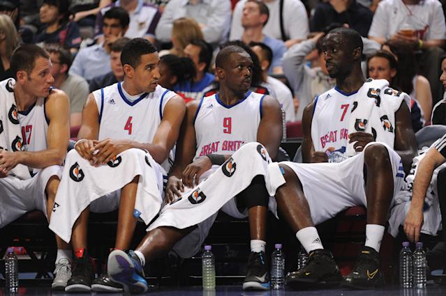 MANCHESTER, ENGLAND - JULY 19: Luol Deng of Team GB (#9) and teamates look on from the bench during their 118-78 defeat during the Men's Exhibition Game between USA and Team GB at Manchester Arena on July 19, 2012 in Manchester, England. (Photo by Stu Forster/Getty Images)