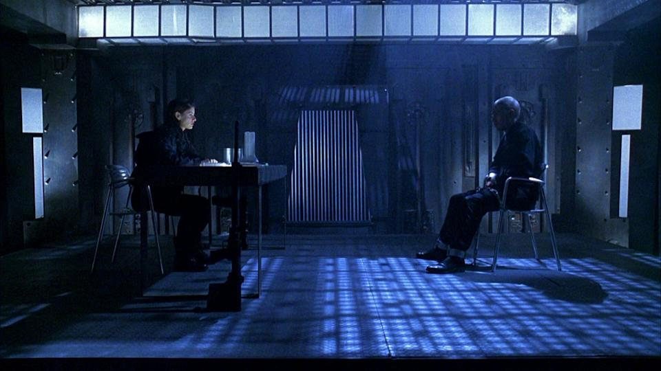 A still from Hellraiser: Bloodline shows a female security guard interrogating a prisoner in a high tech cell