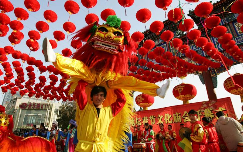 Dancers perform during the opening ceremony of the Spring Festival in Beijing - Getty Images Contributor