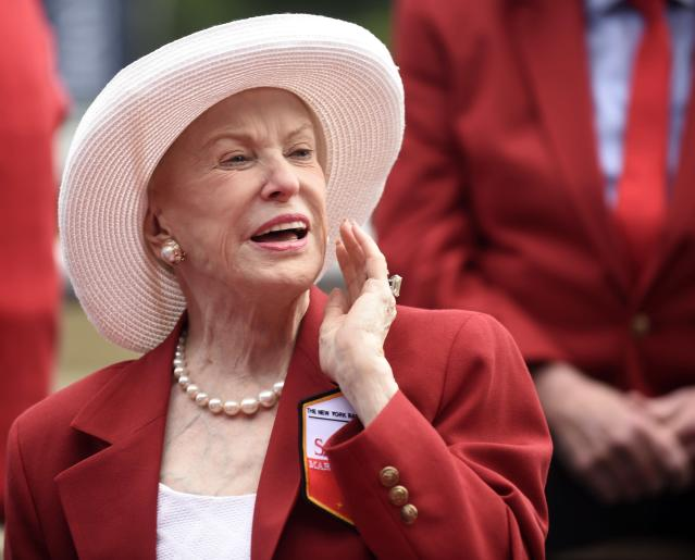 """FILE - In this Aug. 28, 2015 file photo Marylou Whitney of Marylou Whitney Stables talks to reporters after being inducted to the New York Racing Association 2015 Saratoga Walk of Fame during the annual Red Jacket Ceremony at Saratoga Race Course in Saratoga Springs, N.Y. Philanthropist, socialite and horse-racing enthusiast Marylou Whitney, known as the """"Queen of Saratoga,"""" has died at her Saratoga Springs estate after a long illness. She was 93. The New York Racing Association announced Whitney's death on Friday, July 19, 2019 at Saratoga Race Course. (AP Photo/Hans Pennink, file)"""
