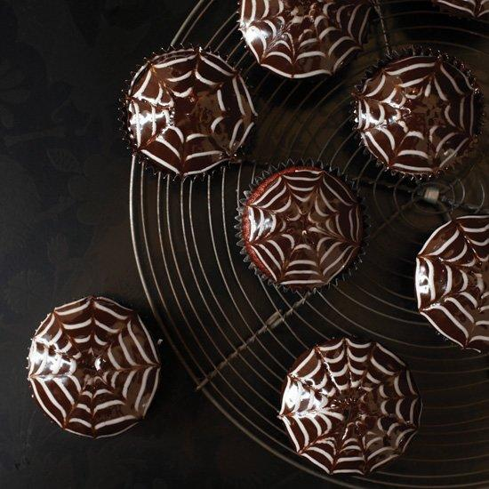 """<p>These web-topped, chocolate-frosted red velvet wonders are filled with a spooky surprise—a sweet and creamy filling loaded with chewy tapioca pearls.</p><p><a href=""""https://www.foodandwine.com/recipes/red-velvet-spider-web-cupcakes"""">GO TO RECIPE</a></p>"""