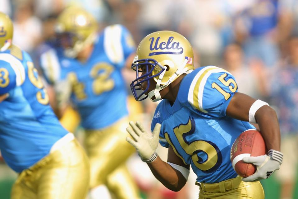 PASADENA, CA - NOVEMBER 10:  Running back Ed Ieremia-Stansbury #15 of the UCLA Bruins runs with the ball during the Pac-10 Conference football game on Novemver 10, 2001 against the Oregon Ducks at the Rose Bowl in Pasadena, California. The Ducks defeated the Bruins 21-20. (Photo by Jeff Gross/Getty Images)