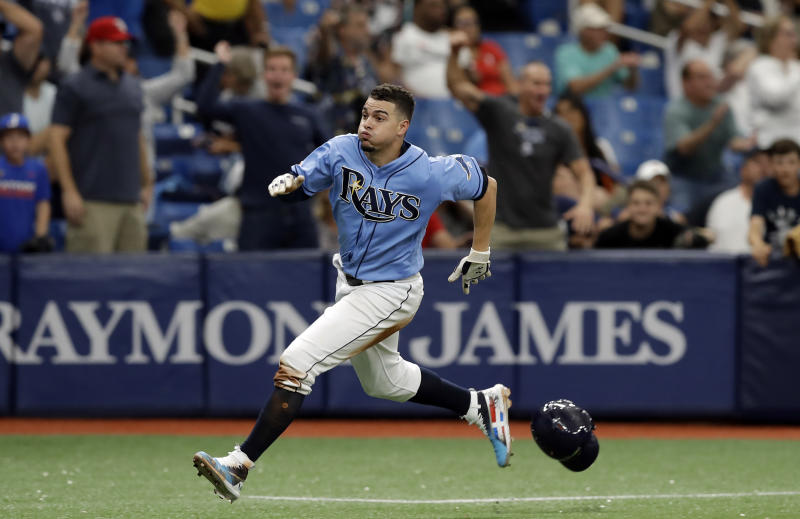Tampa Bay Rays' Willy Adames races home to score what proved to be the game winning run on a two-run single by Ji-Man Choi off Detroit Tigers relief pitcher Joe Jimenez during the ninth inning of a baseball game Sunday, Aug. 18, 2019, in St. Petersburg, Fla. (AP Photo/Chris O'Meara)