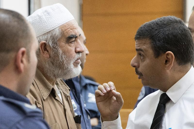 Arab Israeli Sheikh Raed Salah (C), leader of the radical northern branch of the Islamic Movement in Israel, arrives at the Rishon Lezion Justice court near Tel Aviv on August 15, 2017