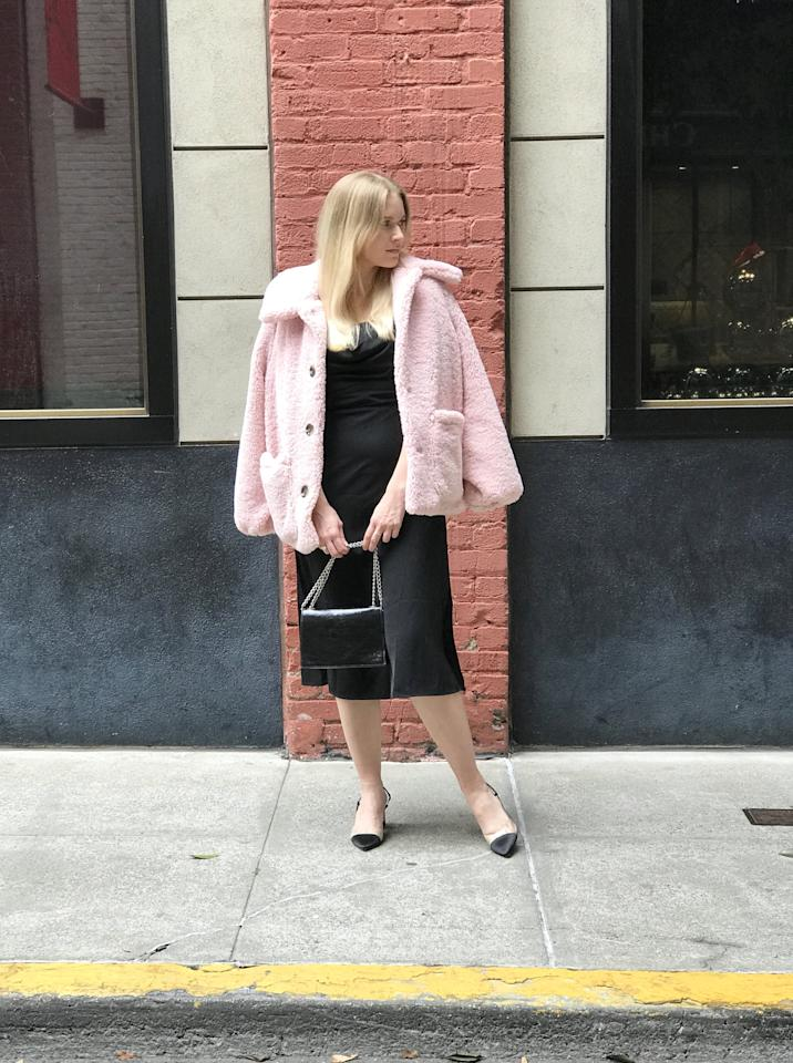"""<p>""""A black LBD and a cute pair of heels is always my go-to event look. Instead of throwing a boring old coat over it, I'll be adding this pink fluffy one to it this season. The fun texture and color are an easy way to spice up any dress (and stay warm). """" - KJ</p>"""