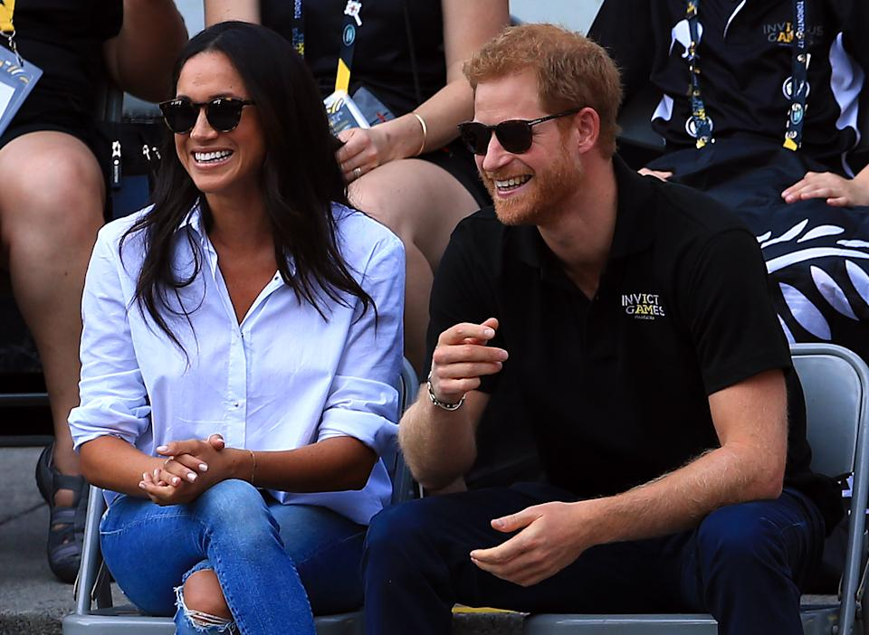 TORONTO, ON - SEPTEMBER 25:  Prince Harry (R) and Meghan Markle (L) attend a Wheelchair Tennis match during the Invictus Games 2017 at Nathan Philips Square on September 25, 2017 in Toronto, Canada.  (Photo by Vaughn Ridley/Getty Images for the Invictus Games Foundation)