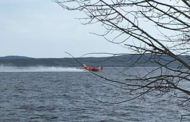 A forest fire near the Town of Buchans is forcing residents around Red Indian Lake to evacuate as a precaution.  (Town of Buchans/Facebook - image credit)